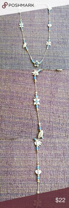 """Sterling Silver Multi Charm Necklace Sterling silver with a fish, a butterfly, a leaf, a flower, a heart and a hand. Has blue and silver beads throughout. Measures 8 1/2"""" Jewelry Necklaces"""