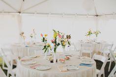 tented wedding receptions - photo by Red, White and Green Photography - http://ruffledblog.com/swansboro-backyard-wedding/wedding