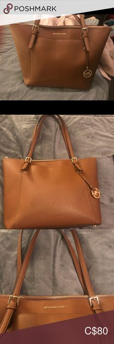 U Micheal Kors Authentic voyager tote. The lining on the shoulder strap is slightly ripped off- see pictures. Great throw it all bag for everyday use. Womens Tote Bags, Michael Kors Bag, Totes, Shoulder Strap, Best Deals, Pictures, Closet, Things To Sell, Travel