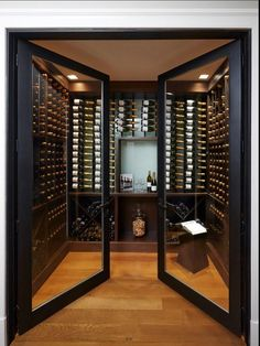 The double glass doors on this wine cellar add a sort of elegance to the libations. New York Penthouse, Luxury Penthouse, Cave A Vin Design, Home Wine Cellars, Wine Cellar Design, Wine Cellar Modern, Glass Wine Cellar, Modern Wine Rack, Wine Display