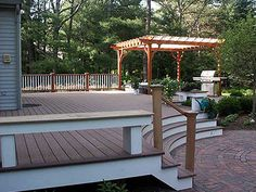 Curved steps from deck to circular patio