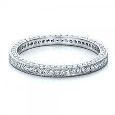 #100148 Dora designs are available at Joseph Jewelry.This elegant eternity band features pave set diamonds on both sides and around the ring. Also available in different metals.