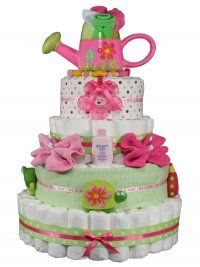Spring diaper cake idea. Cute washcloth flowers and love the idea of baby shoes