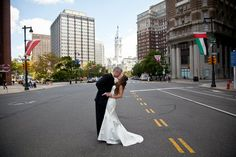 first kiss with city hall in background.