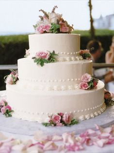 65 best wedding cakes cupcakes images on pinterest dream wedding this small three tiered chocolate cake covered in white buttercream is decorated with pink flowers mightylinksfo