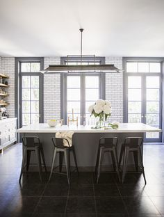 grey kitchen w/ subway tile