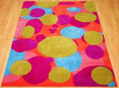 Bright and cheerful, The Butcherbird Rug with bespoke colours and produced in a rectangle. #Interiors