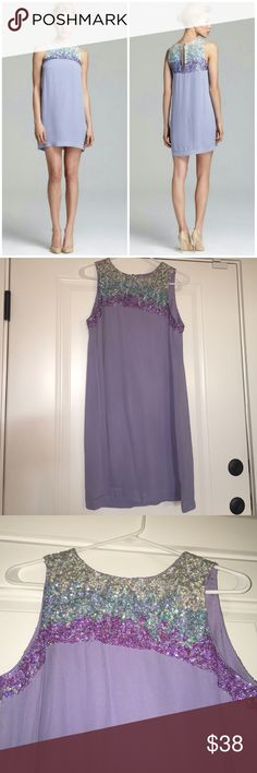 NWOT French connection dress Never worn French Connection dress. Purple, teal and silver sequins. Pictures really don't do this fun and flirty dress justice. Open to reasonable offers. French Connection Dresses Mini