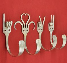 Four Silver plated Dinner forks are bent to represent the hand gestures \