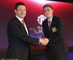 James Wilson (right) is presented with the Jimmy Murphy Young Player of the Year award