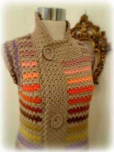 crochet -- Kinda interesting. I'd prefer it for the buttons to be real --black plastic or something--, and the colors could perhaps be helped.