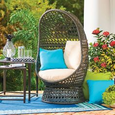 Here's a fresh take on the popular egg-shaped hanging chair (and it's much more stable)! This brown resin wicker patio chair has a metal frame and swivels a full 360 degrees. Easy to assemble, this patio furniture piece has an open weave design that showcases a large and comfy tan seat cushion and pillow set. Patio chair will last for years to come thanks to its durable, weather-resistant resin wicker construction. Its lightweight design also lets you move it about as needed.