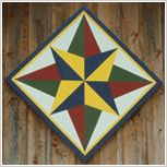 Barn Quilt Top 100 - this site has 100 quilt blocks that could be barn quilts.  They are pretty elaborate though.  I like color/pattern of #79.