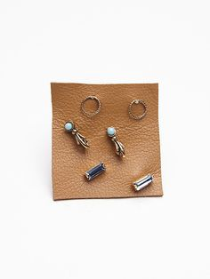 "Free People Tiny 6 Pack Studs, $18.00 I like the set that is listed under ""purple"""