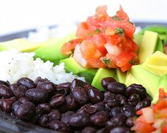 Assortment of Healthy Costa Rican Foods - Beans, lime, lemon, rice, topped with tomato.