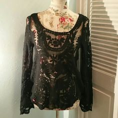 Vtg. Bo-ho Chic Black lacey Bell sleeve blouse  Beautiful sheer design black lacey blouse with flared bottom sleeves. Very Bo-ho chic. This blouse is very versatile. In excellent condition.  Measurements are as follows: 24' length / 18' bust / 26' sleeve length. Vintage Tops Blouses
