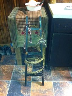 Prim ladder built, painted, distressed and decorated with grapevine and mini LED lights. Love doing these :)