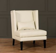 Chelsea Cream Leather Wing ChairInspired by its namesake, the posh New York neighborhood, the Chelsea chair combines the rare qualities of chic design and traditional comfort. The Chelsea Wing Chair is available in Grey or cream bonded leather.Dimensions30.5