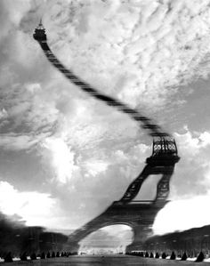 Art from Photo: Robert Doisneau. The Eiffel Tower, distorted sky ward. Intriguing architecture, dotted clouds above.