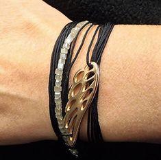 Necklace, Bracelet, Handmade, Greek jewelry, Beaded necklace, Metallic wing, Made in Greece, Boho style, bronze, Angel wing, Charm #black #bracelet #wing #beads #boho #bohemian