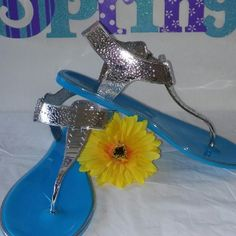 Baby Blue and Silver Sandals Brand New Baby Blue and Silver Sandals with a snake skin texture buckle around the ankle fits nice around the toes.jelly bottom size 8 women's or teens Shoes Sandals
