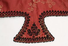 Flap of the sleeve, detail of the decoration with black silk outtoura - detail from Very long silk foustani (dress) with skin-tight bodice and pleated short-waisted skirt, Ioannina Epirus