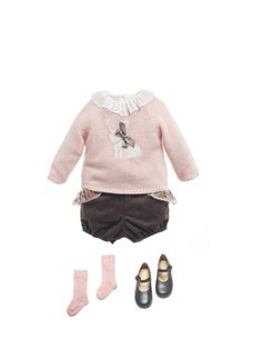This baby girl outfit is beautiful & it has a bunny.