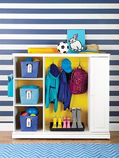 After: Entryway Organizer. Do this with the old entertainment center in the garage for the laundry room?