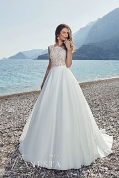 """The beautiful beach setting of Italian bridal brand Lanesta 2017 """"Heart Of The Ocean"""" collection isn't the only thing we're crushing on. The flowing skirts"""