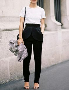 The Crewneck Tee  The ubiquitous crewneck is simple, sleek… and sometimes astoundingly expensive. Though you can, of course, keep it casual with shorts or jeans, we like to take it out on the town with pleated, semi-slouchy trousers and feminine sandals. Minimalist chic.