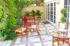 Come, enjoy relaxing patios amid lush tropical gardens at The Escalante