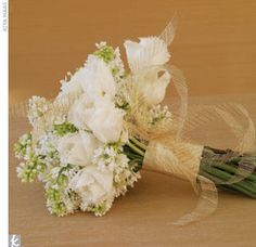 White & green bouquet wrapped with a champagne ribbon