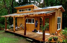Rustic shed with covered porch. Relax and listen to the rain fall on your metal roof! :-)