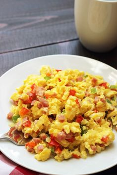 Denver Scramble | Life as Mom - The Denver Scramble is an easy, filling breakfast. Ham, onions, and peppers are tucked into pillows of scrambled eggs. Yum!