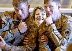 Kristy Brock poses for photos with her two sons Jake Farrow, left, and Justin during the return ceremony for more than 200 Oklahoma National Guard 45th Infantry Brigade Combat Team troops.