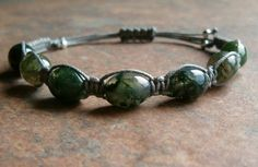 Moss Agate Barrel Bracelet ~  Moss Agate is considered one of the most powerful of the agates. Moss agate balances emotional energies, helps to let go of anger & resentment, draws abundance, enhances concentration, persistence, endurance & success and allows one to see the beauty in life.
