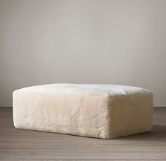Fulham Shearling Ottoman $1695    An oversized silhouette clad in sumptuous shearling with deep padding offers exceptional comfort and relaxed style.