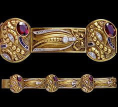 This is breathtaking.  Art Deco Dragonfly Bracelet   Gold Garnet Diamond Synthetic Sapphire Marks: 'COZZOLINO'  Uruguay, c.1930  Cozzolino worked in Naples, Italy & Montevideo, Uruguay   His jewels were wonderful & unique