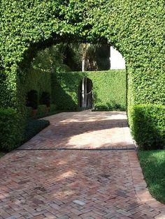 Good looking herringbone brick driveway, and wonderful hedge, looks like Palm Beach. Idea for sidewalk next to future garage Brick Driveway, Driveway Design, Brick Paving, Driveway Entrance, Cobbled Driveway, Brick Path, Driveway Ideas, Cobblestone Driveway, Brick Fence