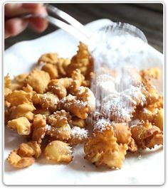 Italian Cenci Ingredients:    1½ cups flour  1 teaspoon baking soda  ¼ teaspoon salt  4 Tablespoons confectioner's sugar  2 eggs  2 Tablespoons butter, room temperature  zest of 1 orange  2 Tablespoons Vin Santo or Rum  Canola oil for frying  for the topping:    additional confectioners sugar  honey (optional)