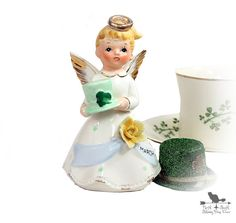 Brimming with an afterglow of yesteryear, we are pleased to offer this angelic March figurine that is 5 inches tall x 3 inches wide. She has