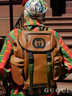 38a1e6afc49 A printed leather backpack featuring the GG motif and the Web stripe from  the Gucci-