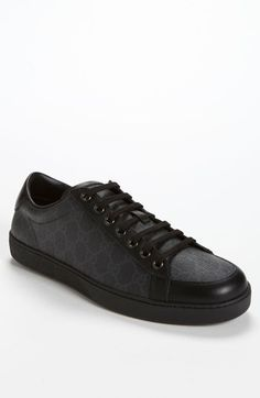 A clean brand print labels a low-top sneaker paneled in soft, finely grained leather. Color(s): black gg print. Brand: Gucci. Style Name: Gucci 'Brooklyn' Sneaker. Style Number: 698589. #gucci #coupay #coupons
