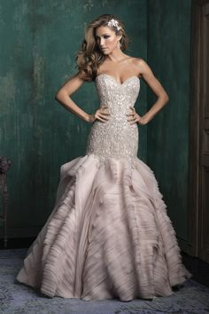 C346 Allure Couture Bridal Gown -Statuesque in design, this couture bridal gown features columns of organza ruffles – offsetting the richly beaded bodice.
