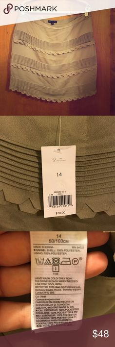 Banana Republic Skirt Banana Republic Skirt. Size 14. Color is a silvery taupe. Side zipper. Fully lined. See pictures for more details. Brand new with tags. Reasonable offers welcome. Bundle and save! Banana Republic Skirts