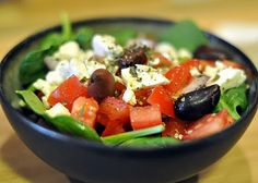 Greek Salad.  Might combine all ingredients from the lemon juice down to make the dressing though.  I would also add chopped lebanese cucumbers instead of the mixed baby greens as an alternative.