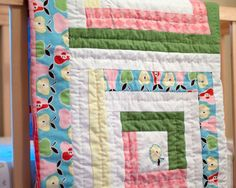 Pretty Pastels Log Cabin Baby Quilt - Free printable pattern for a baby quilt pattern that makes a great quilt for boys and an adorable quilt for girls. Just choose your baby blanket pattern colors for the baby of your choosing!