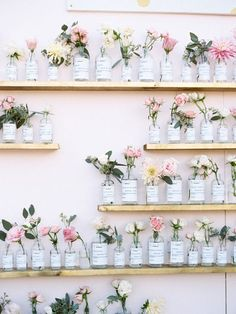 DIY Escort Cards: Vintage Pharmacy Bottle Vases | how to use vintage pharmacy bottles | decorating with flowers | vintage home decor | DIY home decor | decorating for spring and summer | flower home decor ideas | how to decorate with flowers || Glitter, Inc.