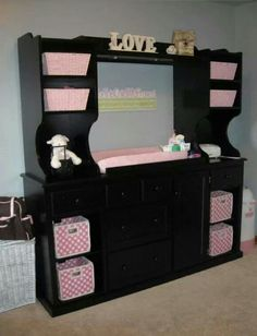 Turn an old entertainment center into a Baby Center