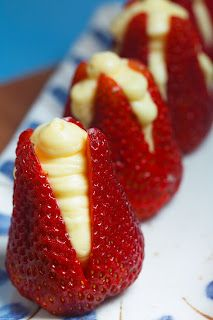Strawberries Filled with Almond Cream-25 jumbo strawberries,       3/4 c heavy whipping cream,       3/4 c milk,       1 small box vanilla instant pudding,       1/2 tsp almond extract.